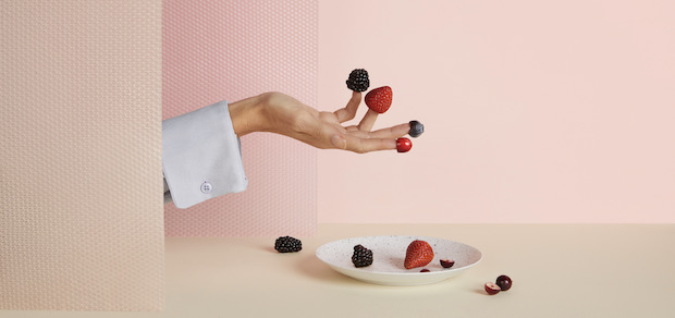 Hand and dish with berries