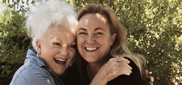 female women friends smiling