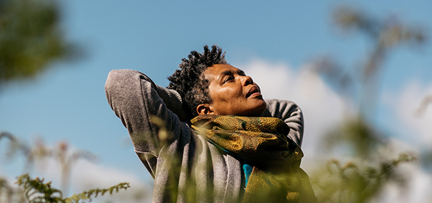 woman looking to the sky with a sense of release