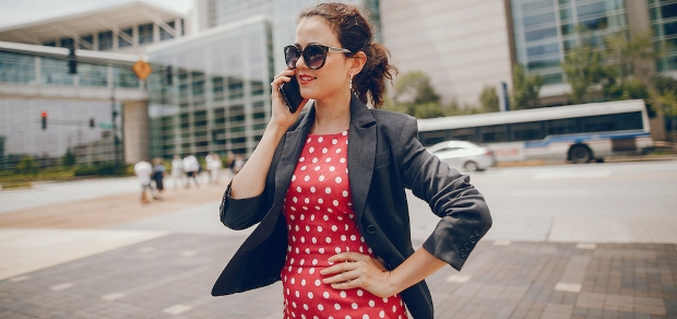 professionally dressed woman on the phone