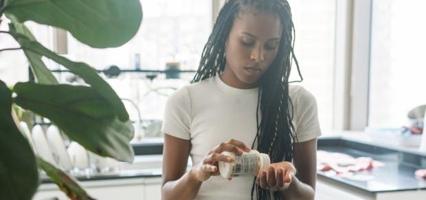 woman taking her vitamins